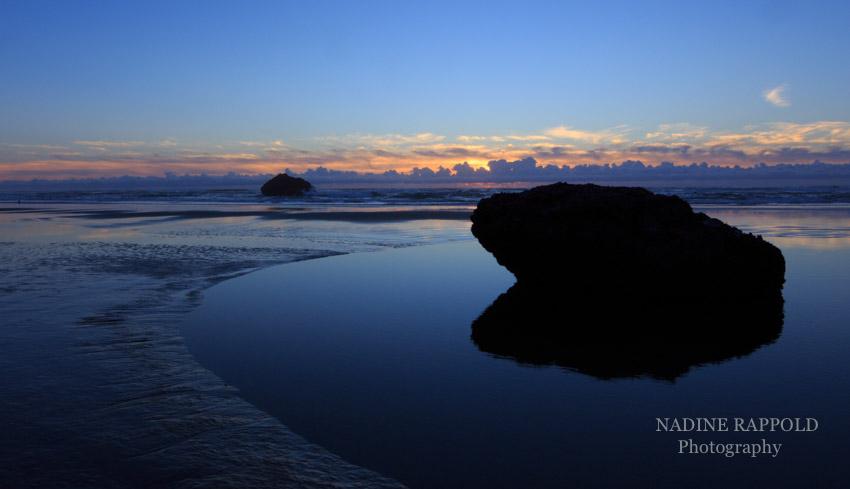 Westküste Oregon Sonnenuntergang mit Fels, USA